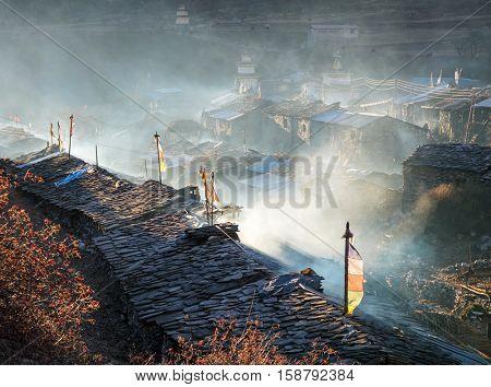 Sunrise view of traditional Nepali village in high hymalaya mountains. Manaslu circuit
