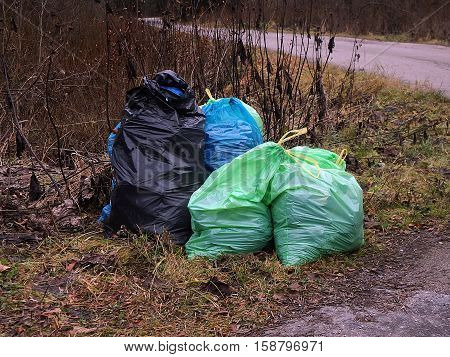 separated waste in the forest , bags of garbage in the woods