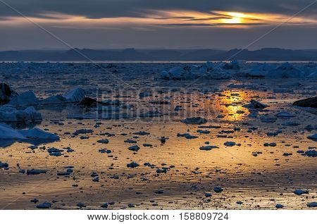 Sunset over Disko Bay in Grenland. Disko Bay is located in the western coast of Greenland and constitutes a wide southeastern inlet of Baffin Bay