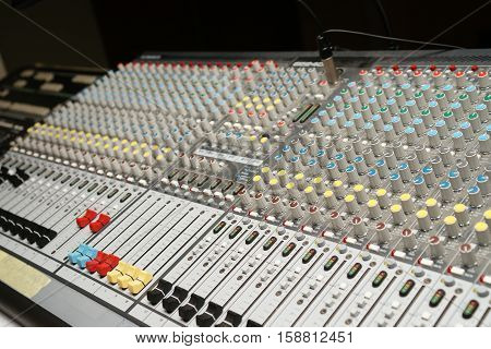 Photography of a colorful sound mixer control