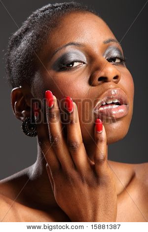 Black girl with red nails