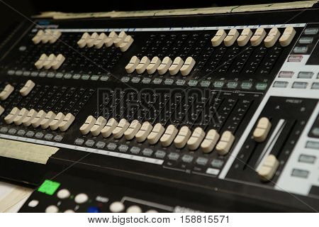 Photography of a black sound mixer control