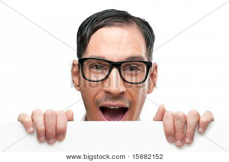 Surprised and shocked happy nerd holding white placard isolated on white background