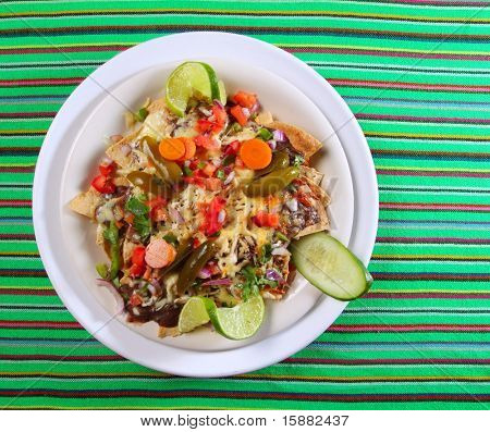 Nachos totopos prepared with cheese vegetables chili Mexican food style