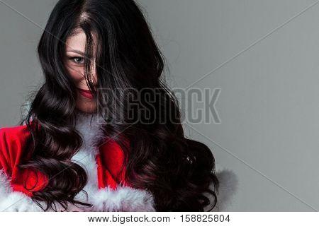 Portrait of beautiful woman wearing santa claus costume