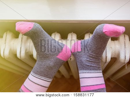happy feet on the white warm radiator