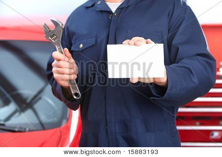 Mechanic with wrench and card. Auto repair shop.