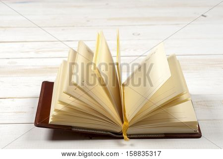 Open book on light table. Back to school. Copy space