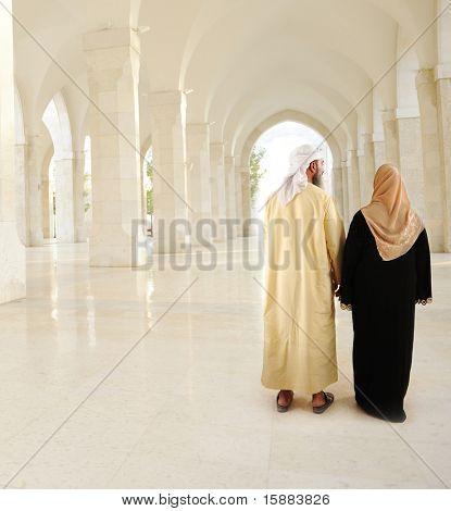 Muslim Arabic couple inside the modern mosque