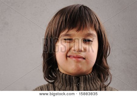One kid - many faces, series of clever schoolboy 6-7 years old with facial expressions