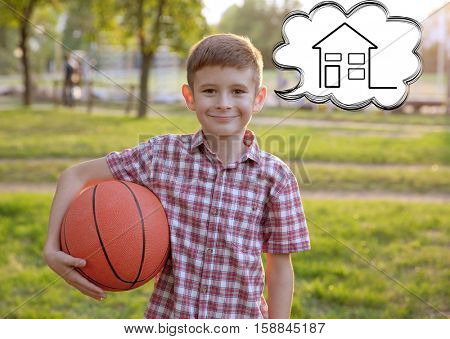 Cute boy dreaming of home. Adoption, custody and childcare concept.
