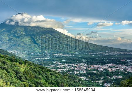 View of Agua volcano towering over Spanish colonial town & UNESCO World Heritage Site of Antigua in Panchoy Valley, Guatemala, Central America