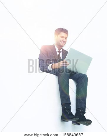 Happy businessman sitting on a banner