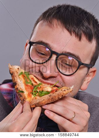 Nerd eating pizza portrait.