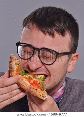 Nerd eating pizza portrait.