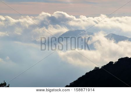 Clouds surrounding mountain ridges taken in Mt Baldy, CA