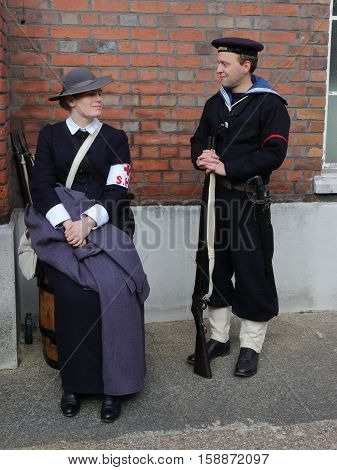 26TH NOVEMBER 2016, PORTSMOUTH DOCKYARD, ENGLAND:Two unknown actors playing the parts of  victorians at the yearly Christmas victorian festival in portsmouth dockyard,england,26th november 2016