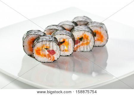 Seafood Maki Sushi - Roll made of Tuna,  Salmon, Scallop and Tobiko (flying fish roe) inside
