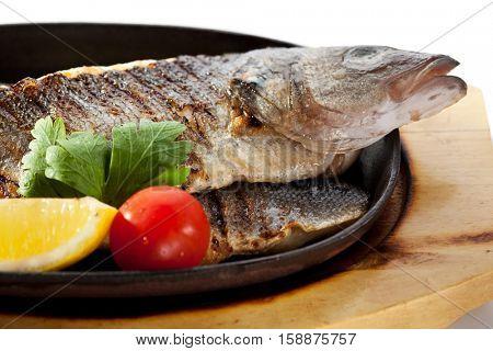 Pan-Fried Sea Bass with Lemon Slice and Tomato