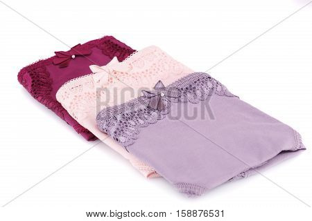 Three colorful panties isolated on white background.
