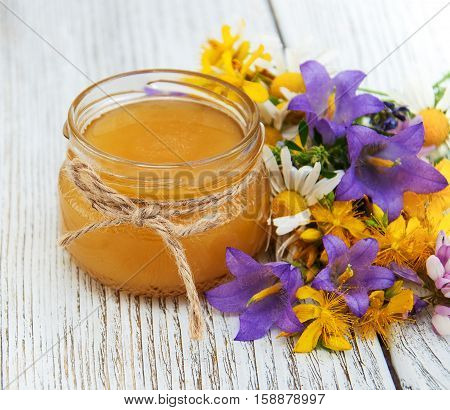 Jar Of Honey With Wildflowers