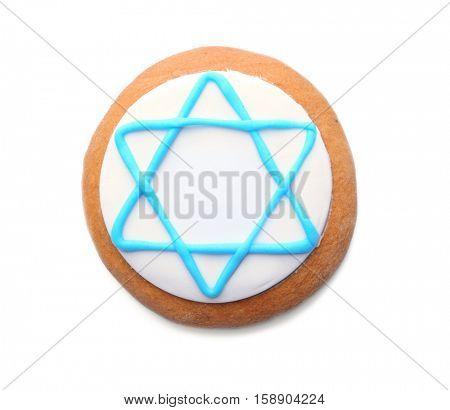 Tasty glazed cookie for Hanukkah, on white background