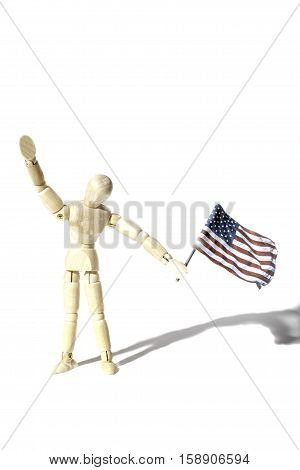 Anonymous American citizen waving a USA flag Represented by a faceless artist mannequin doll. Connotations of citizenship and illegal immigration etc. Shot against a white background with shadow and provinding text space.