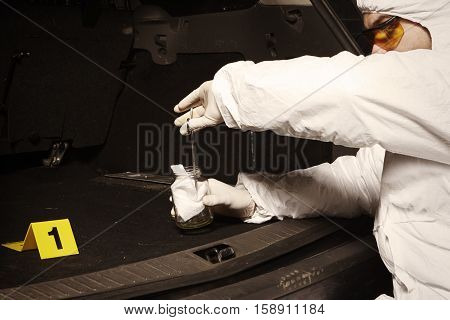 Crime scene investigation - collecting of odor traces by criminologist