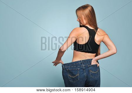 Fit Young Woman In Loose Jeans