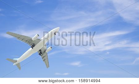 Airplane flying under blue sky and white cloud