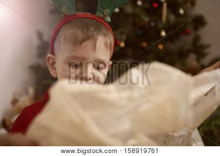 Boy opening his presents
