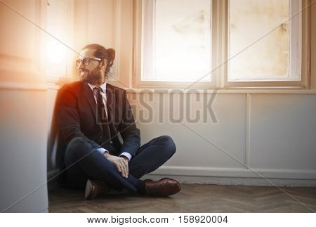 Guy checking the view from the window