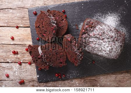 Homemade Cake With Cranberries And Chocolate Close-up. Horizontal Top View