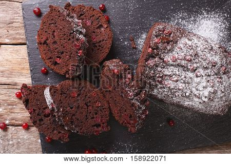 Christmas Chocolate Cake Stuffed With Cranberries Close-up. Horizontal Top View