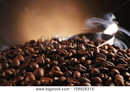 Fresh coffee beans on blurred background