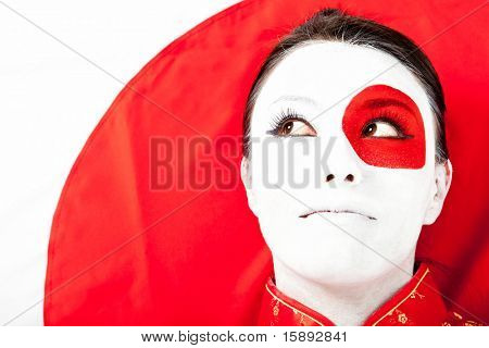 Japanese woman with the flag painted on her face