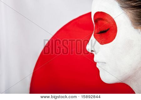 Japanese woman in Asian outfit with the flag behind