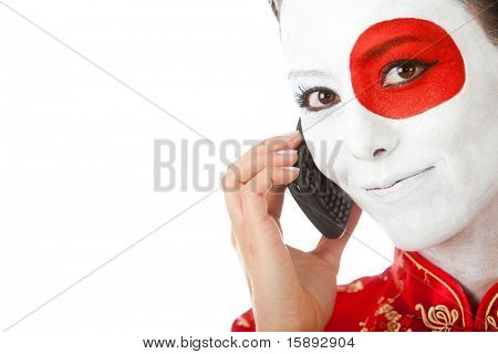 Japanese woman talking on the phone with the flag painted on her face