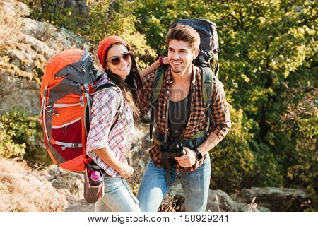 Top view of adventure couple. girl looking at camera. on slope