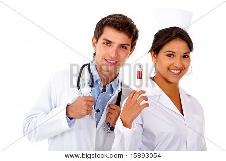 Male doctor and female nurse with a syringe  isolated over a white background