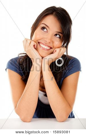 Thoughtful latin woman looking up - isolated over white