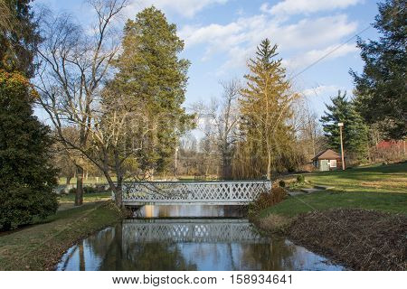 A footbridge crosses a millpond in Carroll County Maryland, USA.