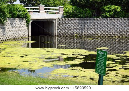 JOLIET, ILLINOIS / UNITED STATES - MAY 18, 2016: Trespassing, boating, swimming, ice skating, and snow mobiling are all prohibited in the Wesmere Country Club's private lake.