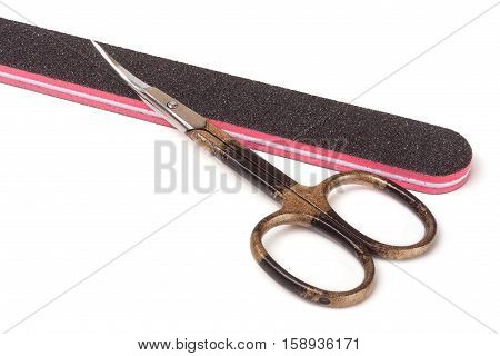 nail scissors and nail file isolated on white background.