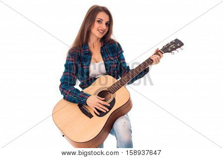 beautiful girl with guitar in hands smiling isolated on white background