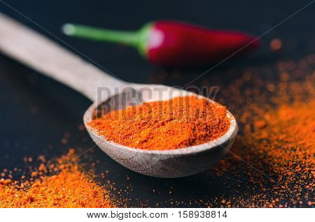 Red chilli peppers, spicy on a wooden spoon. Chilly on a wooden spoon. Vegetable. Concept of hot food.