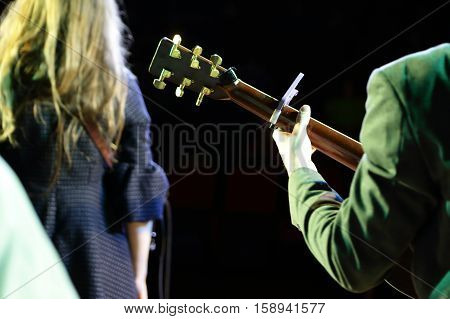 Man playing guitar on a concert stage