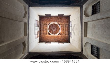 Cairo, Egypt - November 19, 2016: Ceiling of one of the rooms of El Sehemy house an old historic Ottoman era house in Cairo originally built in 1648 with interleaved wooden windows (Mashrabiya)