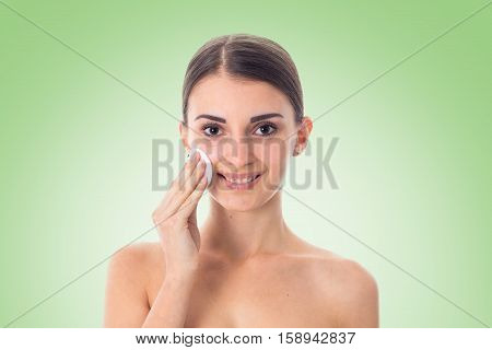 adorable Young girl takes care her skin with Cleansing cotton pad isolated on white background. Health care concept. Body care concept. Young woman with healthy skin.