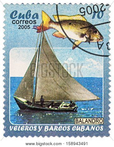 MOSCOW RUSSIA - NOVEMBER 29 2016: A stamp printed in Cuba shows yacht and fish series